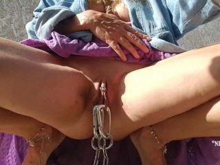 my stretched labia piercings connected with chain dangling from my multiple pierced pussy outdoors